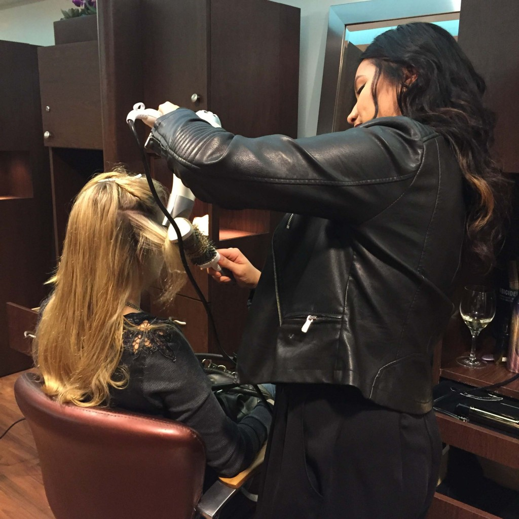 "Rock Spa & Salon stylist, Cindy, giving one of our players ""The Sleek Look"""